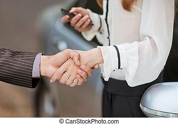 Business transaction, she shakes ha