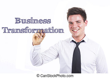 Business Transformation - Young smiling businessman writing on transparent surface
