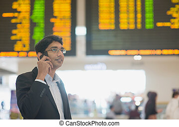 Business travel - Asian Businessman on the phone during his...