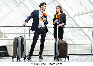 Business Travel - Businessman and business woman...