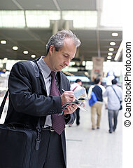 Business travel - Businessman at the airport