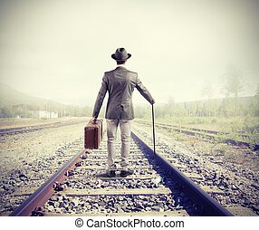 Business travel - Businessman on railway walking for new...