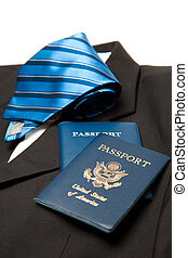 Business travel - A shot of a suit and tie and passports,...
