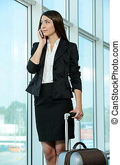 Business Travel - Business woman in business trip with bag...