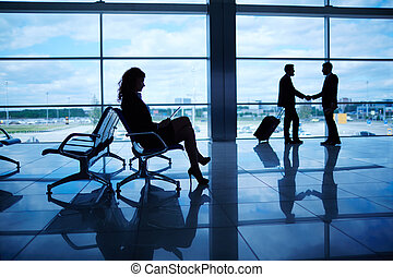 Business travel - Outline of businesswoman sitting in...