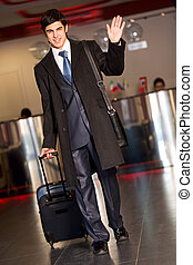 Business travel - Portrait of handsome businessman walking...