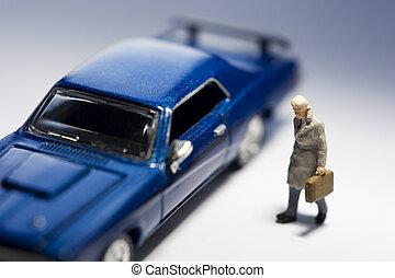 Business travel - Businessman figurine with briefcase...