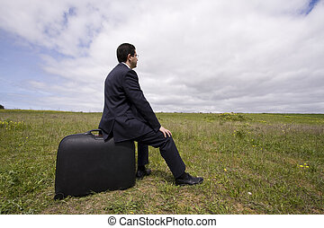business traveler, businessman sit in his baggage