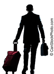 business traveler man walking with suitcase  rear view
