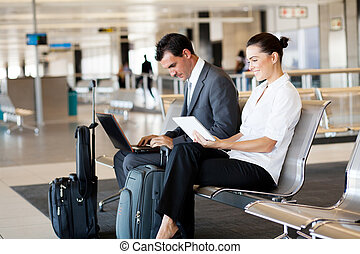 business travelers at airport - business travelers waiting...