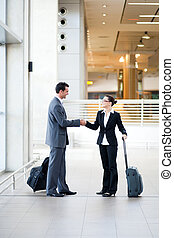 business travelers meeting at airport