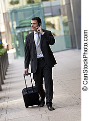 Business Traveller - Successful businessman traveling with...