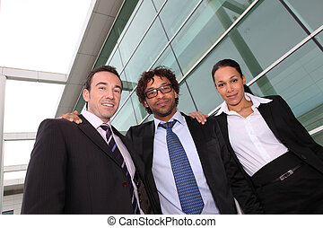 Business trio outside an office building