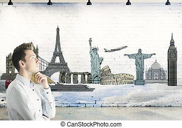 Business trip concept - Side portrait of young businessman...