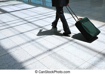 business trip - businessman carry the suitcase and go...