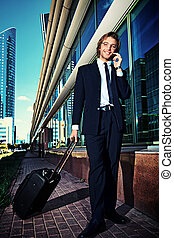 business trip - Business man on the street of the big city...