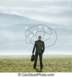 business trip - Businessman in desert with arrows and planes