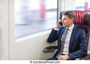 Business trip - Young businessman with phone
