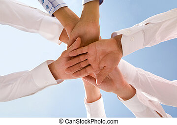 Business union - Bottom view of people hands holding ...