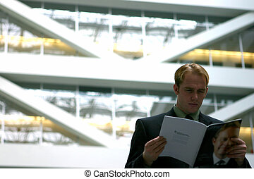 Business vision 29 - Blond hair business man dressed in gray...