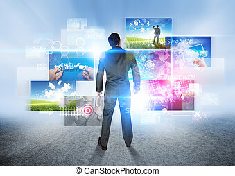 Business Vision - A businessman looking at images.