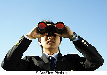 Business vision - Businessman looking through binoculars,...