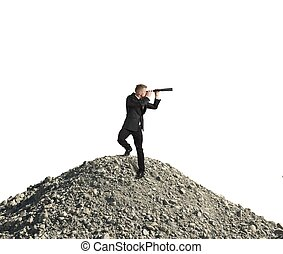 Concept of business vision with businessman with telescope