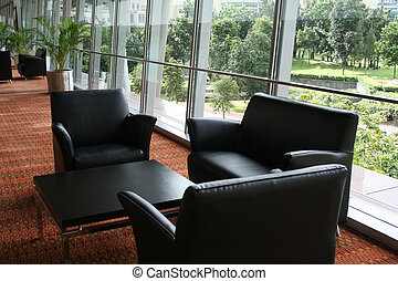 Business waiting area, leather chairs and a nice view