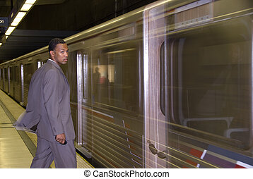 Business waiting for subway