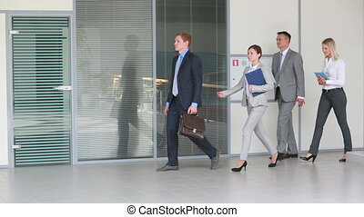 Business walkers - Group of business people walking...