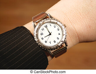 business watch - businessperson checks watch in time for...