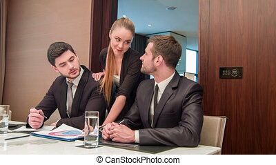 Business with colleagues in meeting room