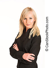 Blond business woman dressed in black trousers and a black shirt. Standing with arms crossed.