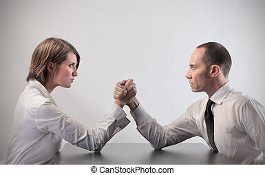 Business woman ad man hand wrestling