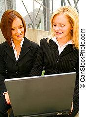 Business Woman Analyzing Laptop
