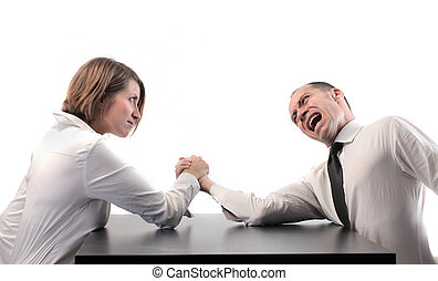 Business woman and man hand wrestling