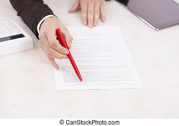 Business Woman asking for signature in a Bank