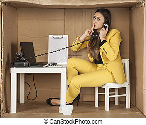 business woman asks for silence during a telephone conversation