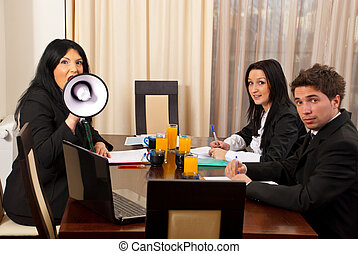 Business woman at meeting with megaphone
