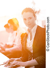 business woman at  office people group on meeting  in background