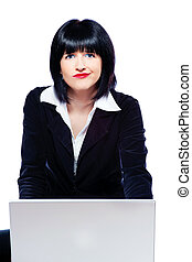 woman behind laptop marveling