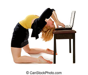 A business woman bending backwards over laptop