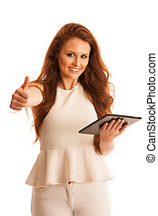 Business woman brousing the web on a tablet showing thumb up as a gesture for success isolated over white background