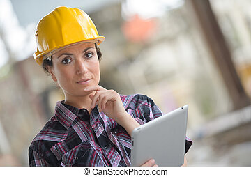 business woman builder working with tablet