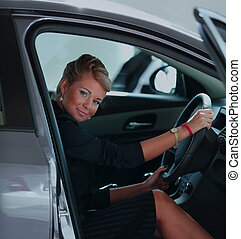 Business  woman buying a car at dealership