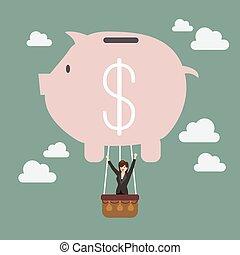 Business woman celebrating in piggy bank balloon