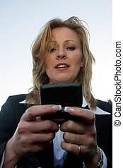 checking message - Business woman checking message