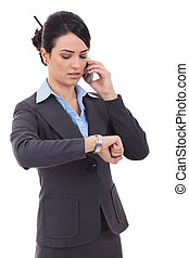 business woman checking time on phone