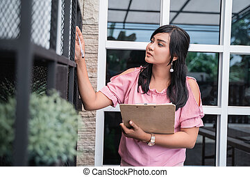 business woman checklist with clipboard in office