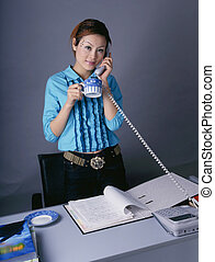 Business Woman - chinese young lady at work